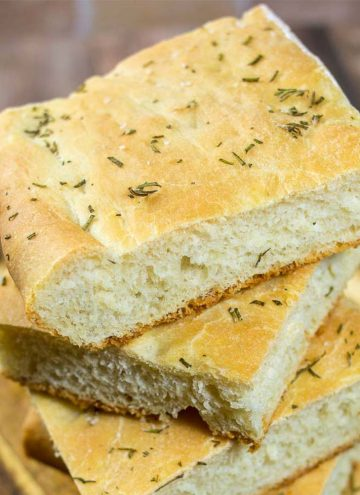 Focaccia is an Italian flat bread similar to the crust of Sicilian pizza. It is moist, chewy, and topped with savory rosemary.