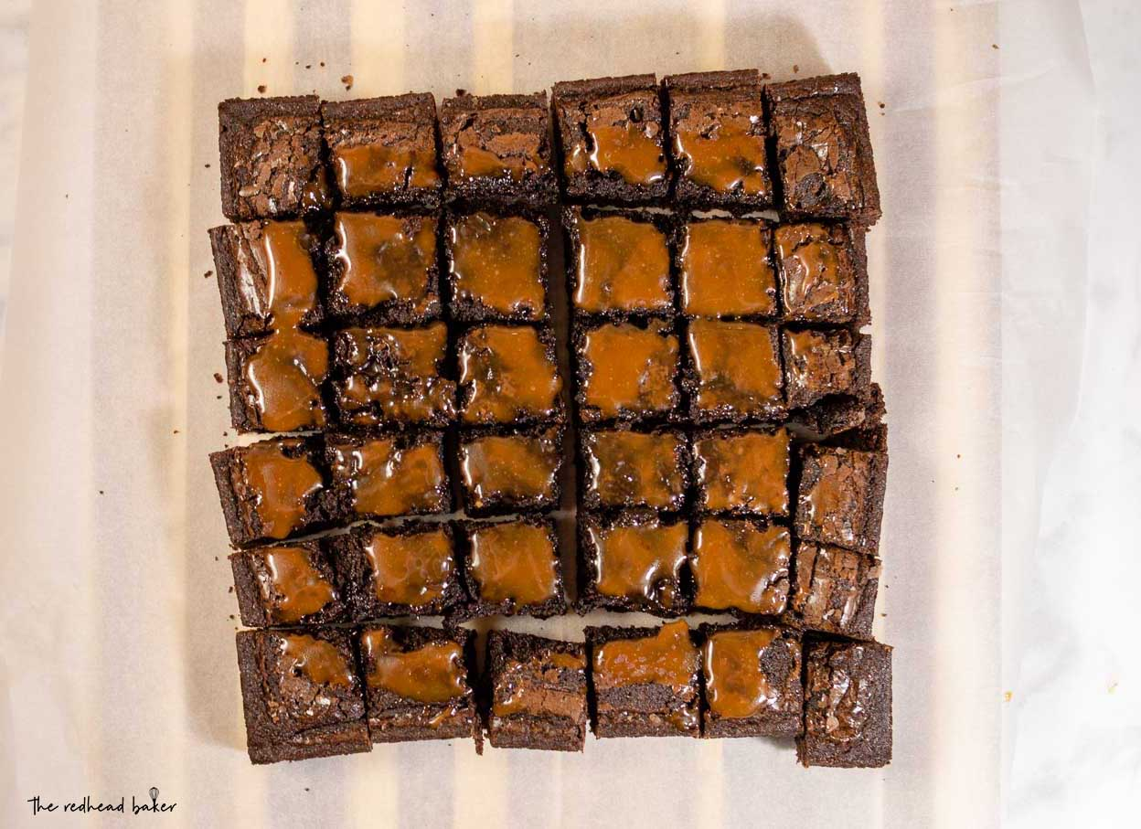An overhead view of 36 squares of salted caramel brownies