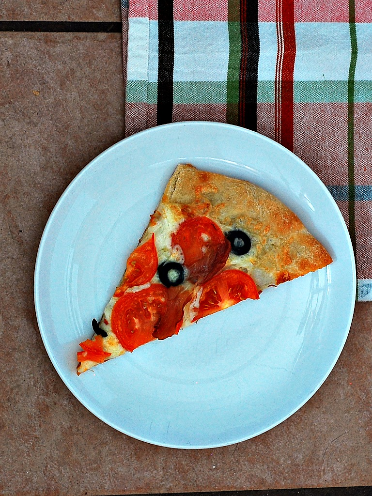 Pizza with Fontina, Tomatoes, Olives and Prosicutto