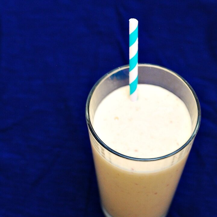 Peach Mango Breakfast Smoothie by @TheRedheadBaker