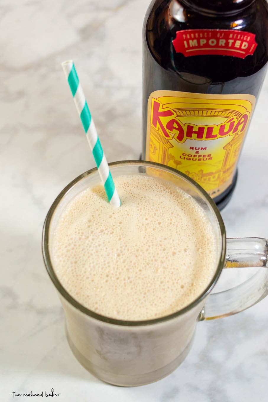 White Russian milkshakes are a twist on the creamy cocktail: coffee ice cream, milk, whipped cream vodka and coffee liqueur blend together in a frozen twist on the classic drink!