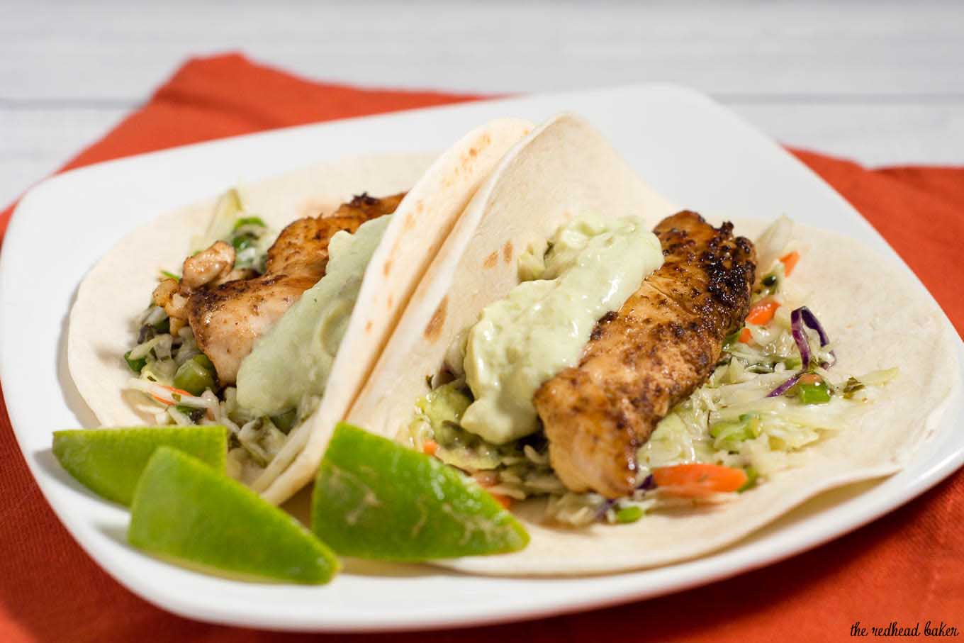 Chicken tacos are spiced with ancho chile powder and topped with cilantro slaw and avocado cream. This delicious meal is ready in under 30 minutes!