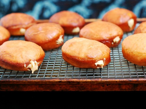 Chocolate-Glazed Peanut Butter-Stuffed Donuts #ChocPBDay | theredheadbaker.com