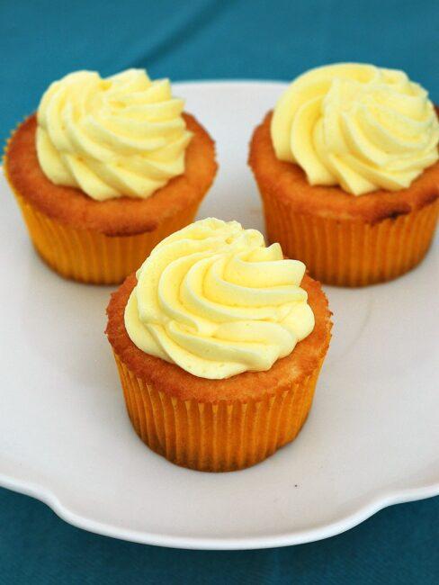 Vanilla Cupcakes with Lemon Curd Filling and Lemon Buttercream #SundaySupper #GalloFamily   theredheadbaker.com