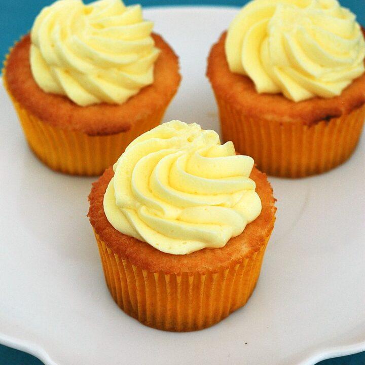 Vanilla Cupcakes with Lemon Curd Filling and Lemon Buttercream #SundaySupper #GalloFamily | theredheadbaker.com