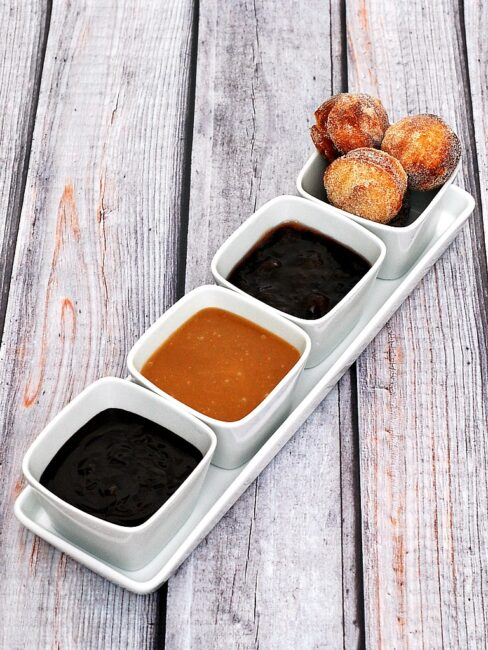 #BrunchWeek continues with sweet sugar-covered fried donut holes, served with three dipping sauces: caramel, chocolate, and blackberry. Bet you can't stop at just one! theredheadbaker.com