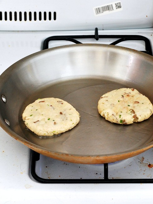 Scottish tattie scones, aka potato scones, resemble pancakes more than typical scones. They combine potatoes, flour, and butter and are sauteed on a griddle. #BrunchWeek theredheadbaker.com