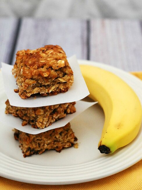 Use up an overripe banana in these tender, delicious banana-oatmeal squares. These treats are low-fat, so it's okay to eat two! theredheadbaker.com #CLBLogger