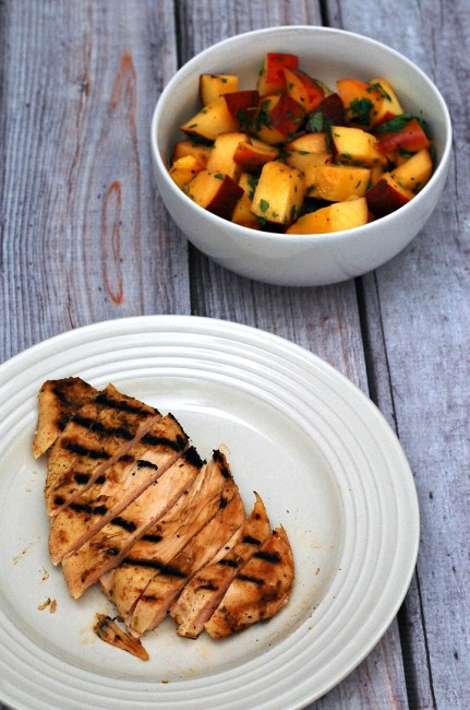 Grilled peach salsa adds a smoky sweet flavor to spiced chicken breasts. Use thin-sliced chicken breasts to cut down on cooking time. #CLBlogger