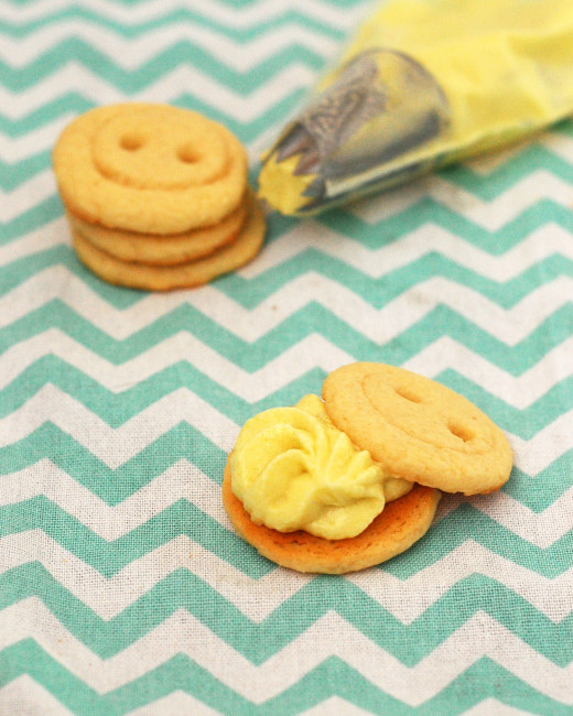 Babies are cute as a button, and so are these adorable little button cookies sandwiched with lemon buttercream! Serve them as a sweet ending to a baby shower. TheRedheadBaker.com