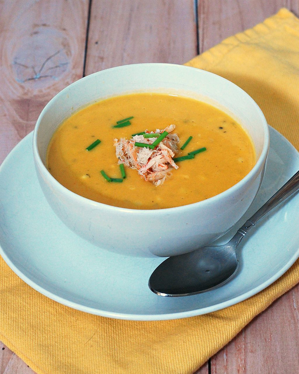 Soup in the summer? Sweet corn shines in this easy, light-but-satisfying summer soup recipe, topped with succulent crabmeat. #SundaySupper TheRedheadBaker.com