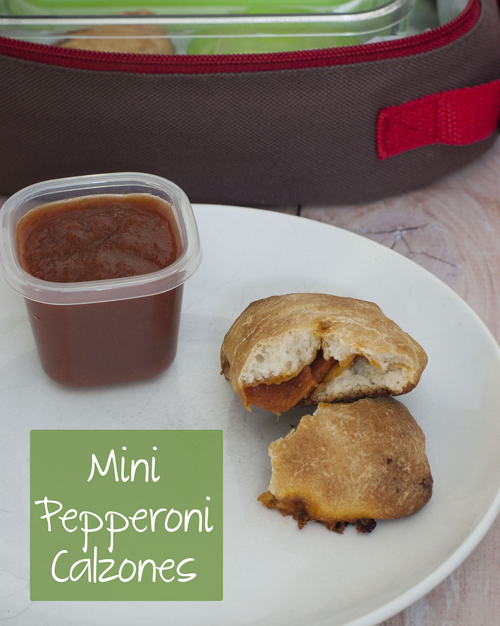 You'll be parent of the year when you send your kids back to school with mini pepperoni calzones. They're easy to make in bulk and freeze. #SundaySupper TheRedheadBaker.com