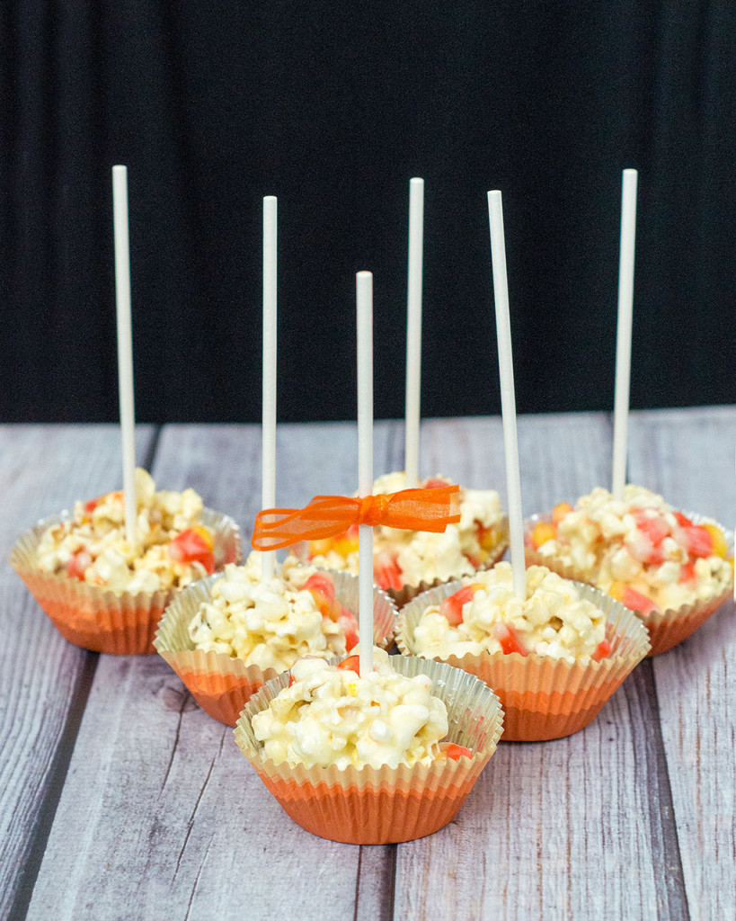 Need a last-minute, no-bake Halloween treat? Try these 5-ingredient candy corn popcorn balls! They're sweet and salty and perfect for all ages! TheRedheadBaker@gmail.com