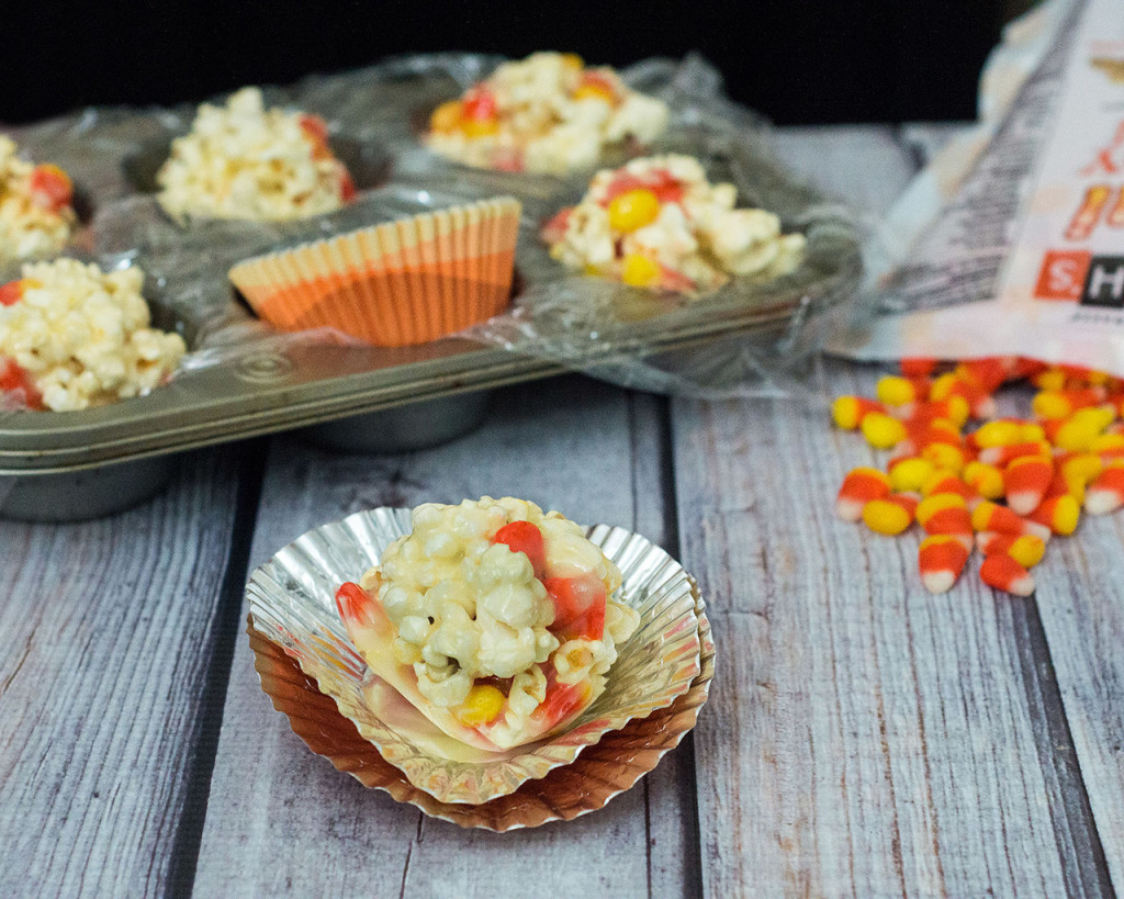 Need a last-minute, no-bake Halloween treat? Try these 5-ingredient candy corn popcorn balls! They're sweet and salty and perfect for all ages! TheRedheadBaker.com