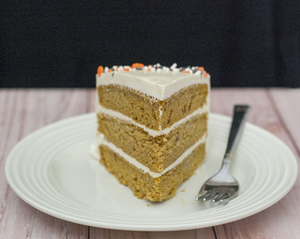 Pumpkin Cake with Salted Caramel Icing is a decadent fall treat. Three layers of moist pumpkin cake is layered with satin-smooth salted caramel Swiss buttercream. #PumpkinWeek