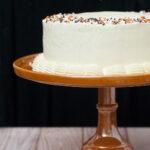 Pumpkin Cake with Salted Caramel Icing is a decadent fall treat. Three layers of moist pumpkin cake is layered with satin-smooth salted caramel Swiss buttercream. #PumpkinWeek