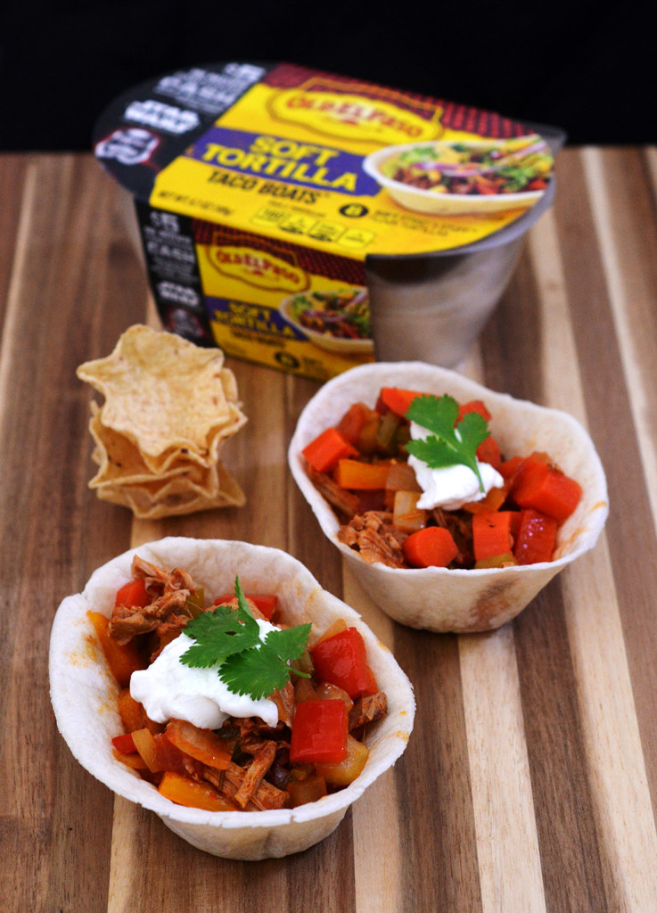 Spice up your Game Day tailgate snacks with these Carnitas Chili Bowls, flavored with Old El Paso™ seasoning and salsa, served in soft tortilla bowls. #oldelpaso #acmemarkets