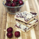 Cherry crumb bars are reminiscent of an American classic, cherry pie, but are less messy, so they're perfect for a potluck or picnic! #SundaySupper TheRedheadBaker