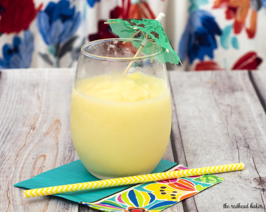 Have a taste of the tropics with a homemade frozen pina colada: a blend of ice, pineapple slices and juice, coconut cream and rum. #SundaySupper TheRedheadBaker.com
