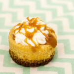 Finish off a tapas-style meal with mini dulce de leche cheesecakes — individual-sized creamy caramel-flavored cheesecakes with a cinnamon-crumb crust. #SundaySupper TheRedheadBaker.com
