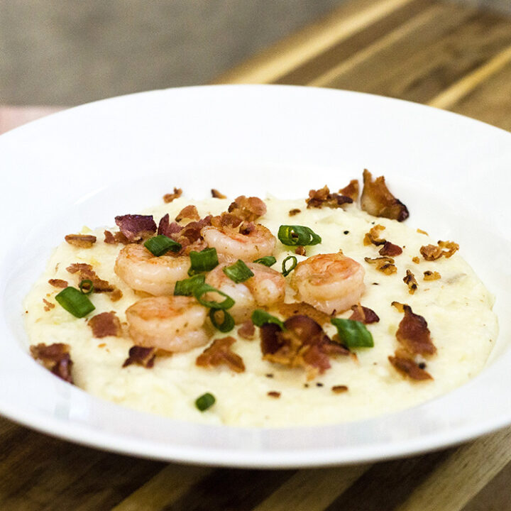 Shrimp and grits are a traditional southern breakfast. Sauteed shrimp are served over grits flavored with sharp Cabot cheddar cheese. #BrunchWeek TheRedheadBaker.com