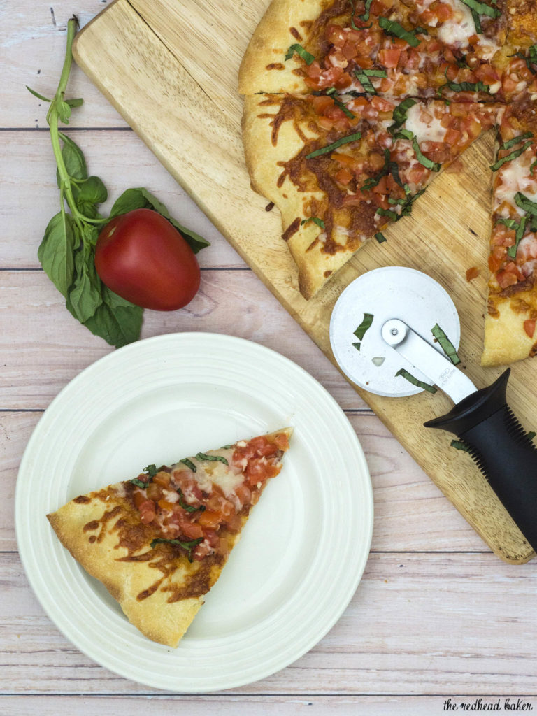 Bruschetta pizza is loaded with fresh summer tomatoes, basil and garlic over lots of melted mozzarella cheese. What better flavor for summer pizza? #ProgressiveEats