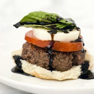 Caprese burgers are topped with the classic flavors of caprese — tomato, basil, mozzarella, and a balsamic reduction sauce. #SundaySupper