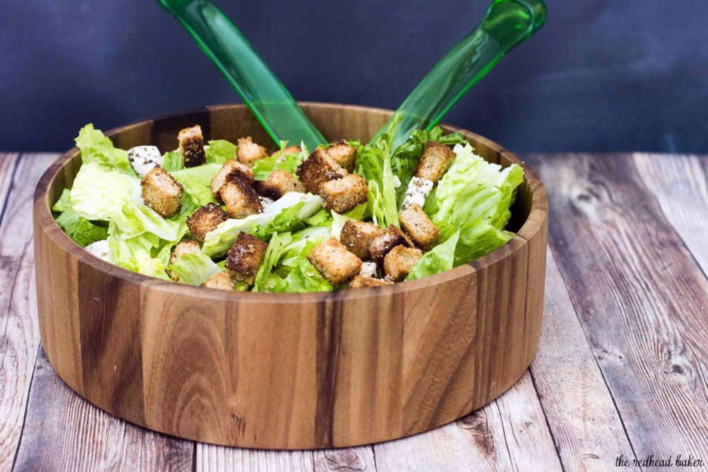 Lighter Caesar salad is delicious, and light on the calories. This version replaces most of the oil and the egg yolks in the dressing with fat-free Greek yogurt, making it creamy, but healthier.