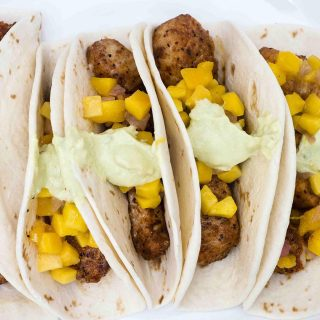 Mahi mahi tacos with mango salsa and avocado crema are a delicious, easy weeknight meal with lots of spice and summer flavor.