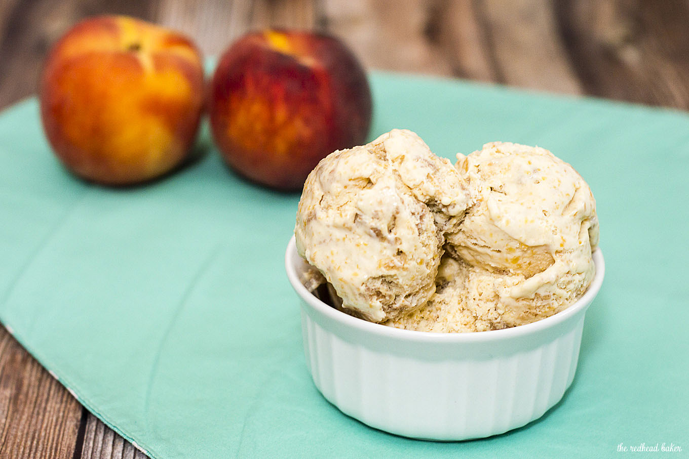 This peach pie ice cream is flavored with roasted peaches and has a swirl of graham cracker crumb crust, and no ice cream maker is required to make it! #SundaySupper