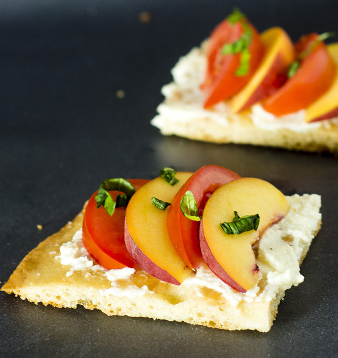 Tomato-peach flatbread is the perfect summer appetizer. You can't beat fresh summer tomatoes and peaches, plus no cooking required! #CLBlogger Recipe at TheRedheadBaker.com