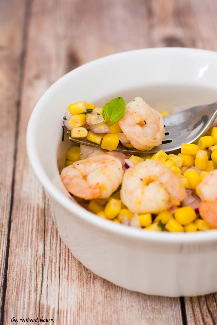 Can dinner be both easy AND healthy? Yes! Serve lemon shrimp over a salad of corn, red onion and basil with a red wine vinaigrette.