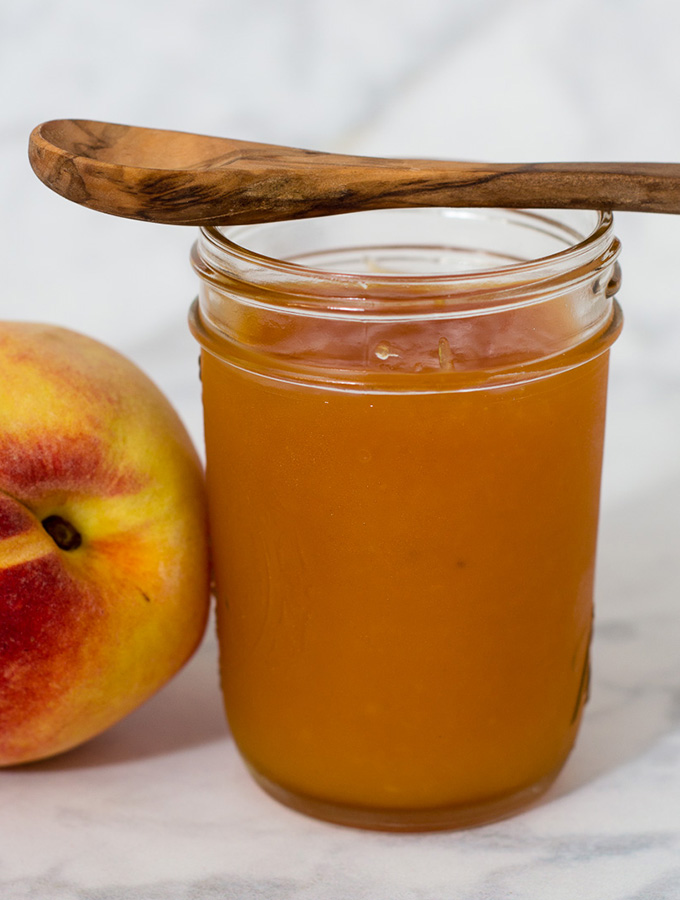 Peach butter is smoother and less sweet than peach preserves, resulting in a purer peach flavor. Canning peach butter preserves the flavor all year long. #SundaySupper