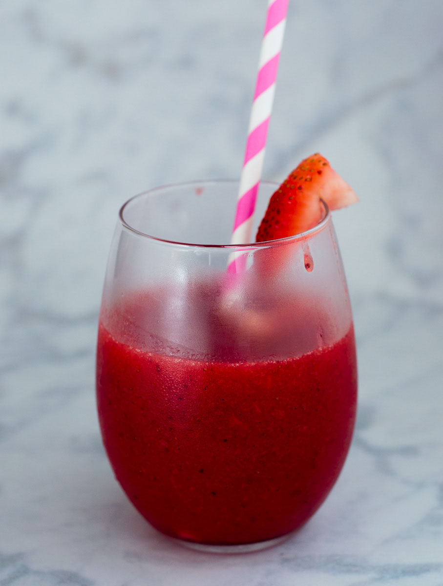 Strawberry sangria slushies are fun frozen cocktail — white wine blends with frozen strawberries and triple sec for a delicious summer treat!