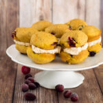 Two soft, light pumpkin cookies studded with fresh cranberries are sandwiched with creamy dulce de leche marshmallow filling.
