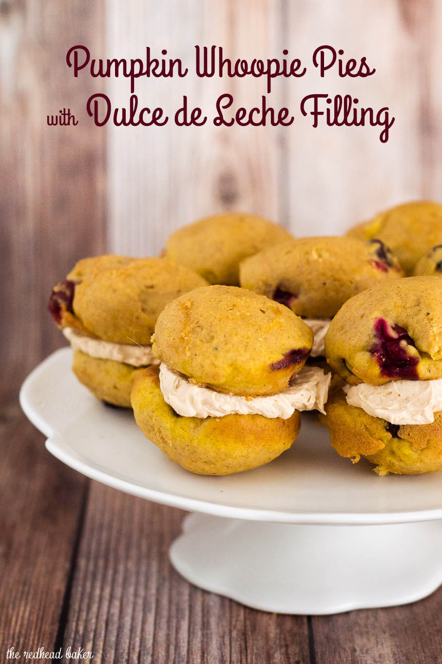 Pumpking Whoopie Pies sandwich two soft, light pumpkin cookies studded with fresh cranberries with creamy dulce de leche marshmallow filling.