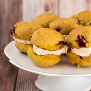 """I liked these big pumpkin-spice cookies when I first made them and thought of them as cookies. But when I sandwiched them with a marshmallow crème and dulce de leche filling, officially turning them into whoopie pies, """"like"""" became too mild a word for how I felt about them. They passed over into love 'em territory, and they've stayed there ever since. The cookies themselves have the soft, light texture and flavor of spice cake. In fact, they'd be exactly like spice cake if they didn't have the surprise of fresh cranberries, which, in addition to adding color and pop, have just the right the amount of pucker to make the sweet a grown-up dessert. As for the filling, sticky, sweet fluff is a must. It's just about part of the definition of whoopie pies. For these, it's paired with store-bought or homemade dulce de leche. It's the perfect combo, but when you're ready for a swap, sandwich the cookies with a spiced cream cheese filling."""