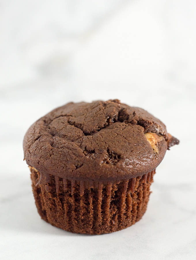 Double chocolate muffins pack a double punch -- rich semisweet chocolate in the muffin batter, and white chocolate chips mixed in. Are they for breakfast or dessert? You decide! #Choctoberfest