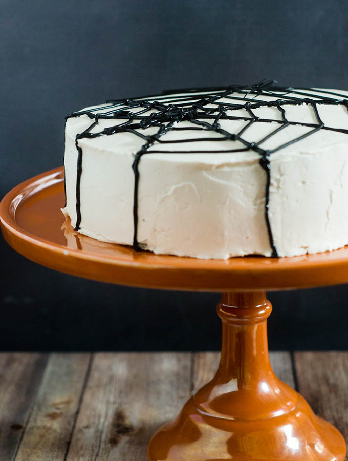 Scare up some fun with this spooky Halloween Spiderweb Cake. It involves basic piping techniques, so it's easy enough for beginner cake decorators!