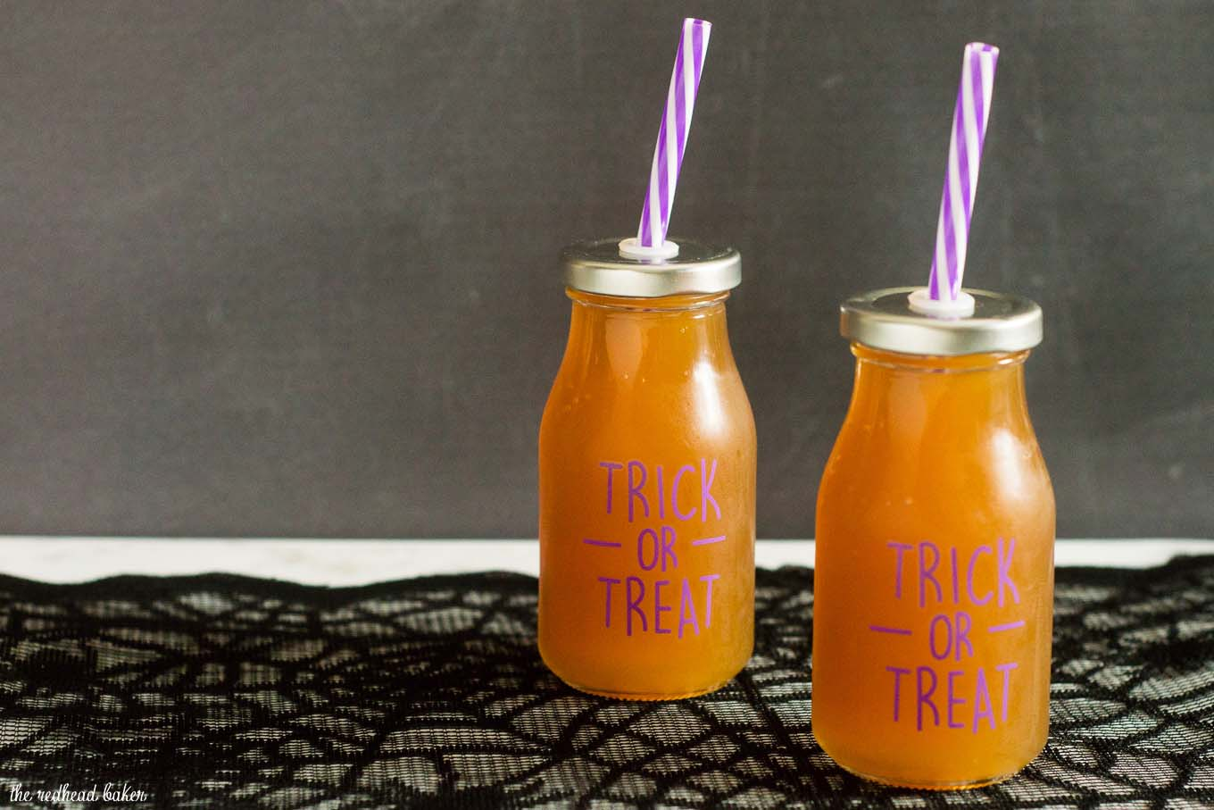 Serve a spooky witch's brew at your Halloween party — a Poison Apple Cider Cocktail, with rum and cinnamon-infused brandy!
