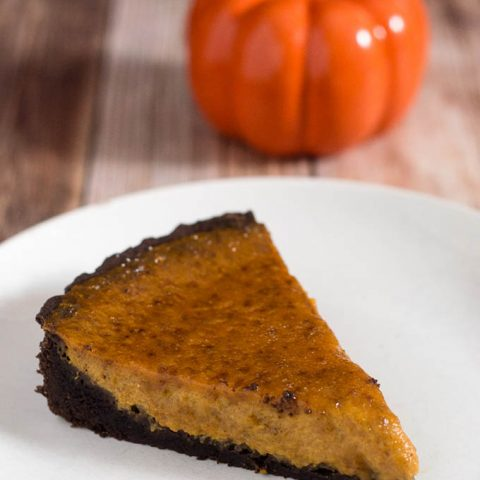 Move over, classic pumpkin pie! Pumpkin brulee tart has a custard-like spiced pumpkin filling baked in a chocolate cookie tart shell, then is sprinkled with sugar and bruleed. #PumpkinWeek