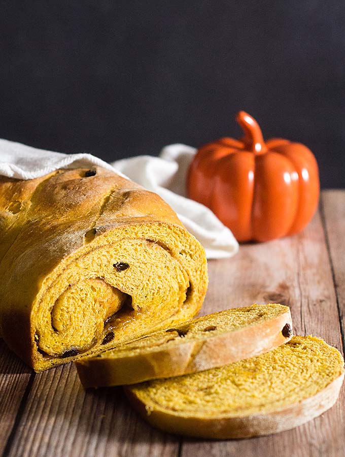 Comfort food with a fall twist — pumpkin cinnamon raisin bread is studded with raisins with a swirl of cinnamon, butter and brown sugar. #PumpkinWeek