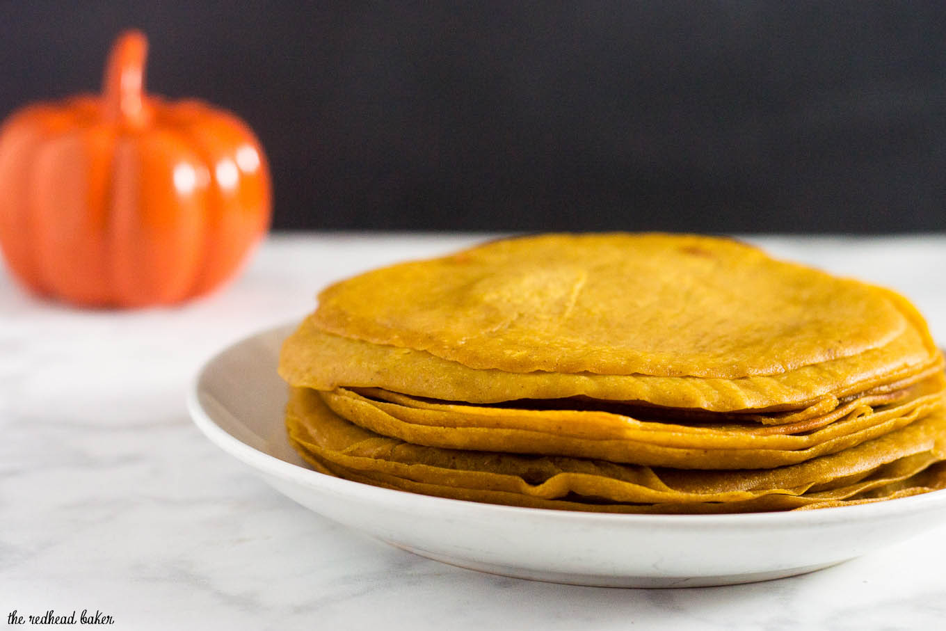Pumpkin crepes are very thin dessert pancakes, folded over sweetened cream cheese filling and drizzled with dulce de leche. #PumpkinWeek