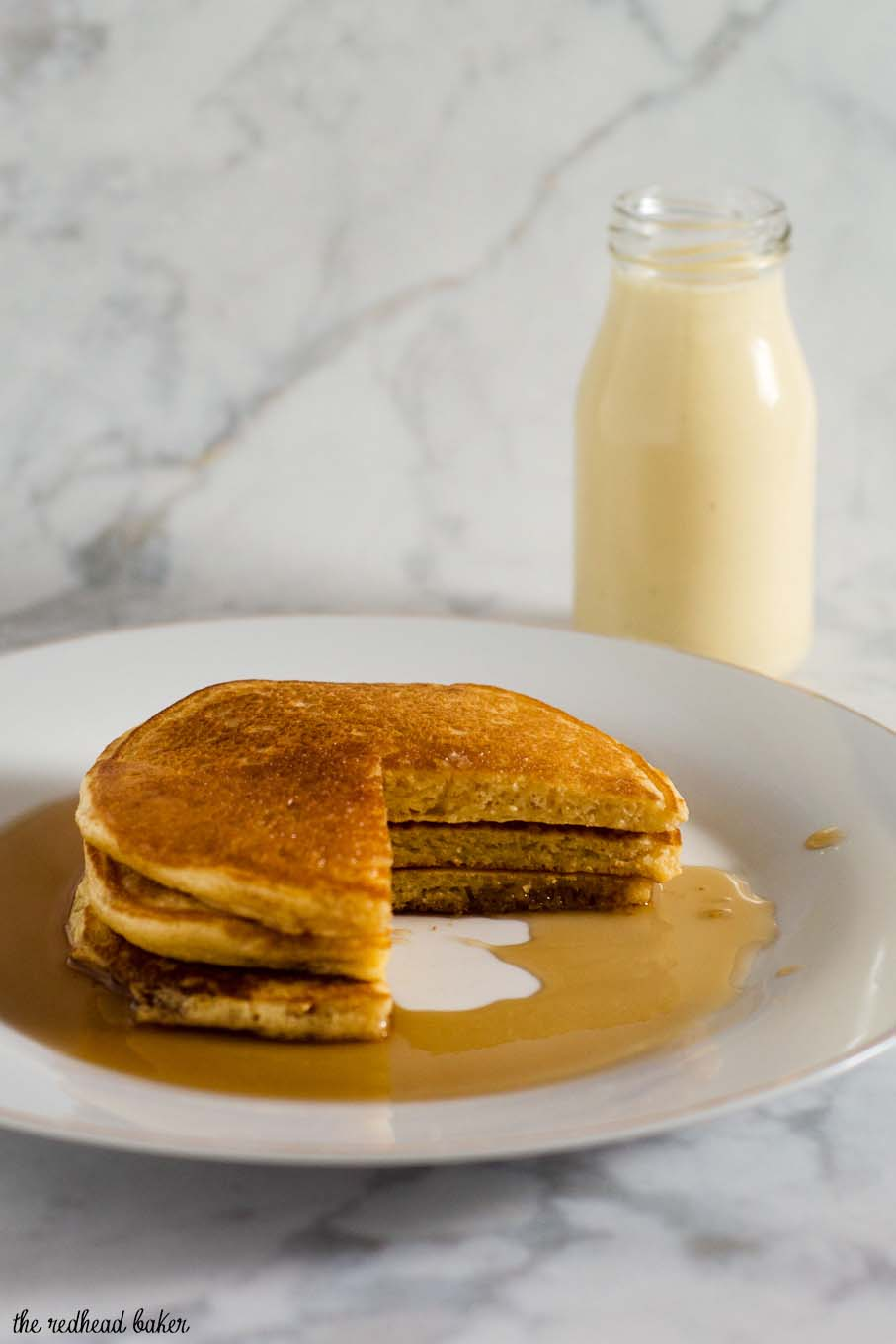 Eggnog pancakes are light and fluffy with the subtle flavor of the traditional Christmas drink, drizzled with nutmeg-infused maple syrup.