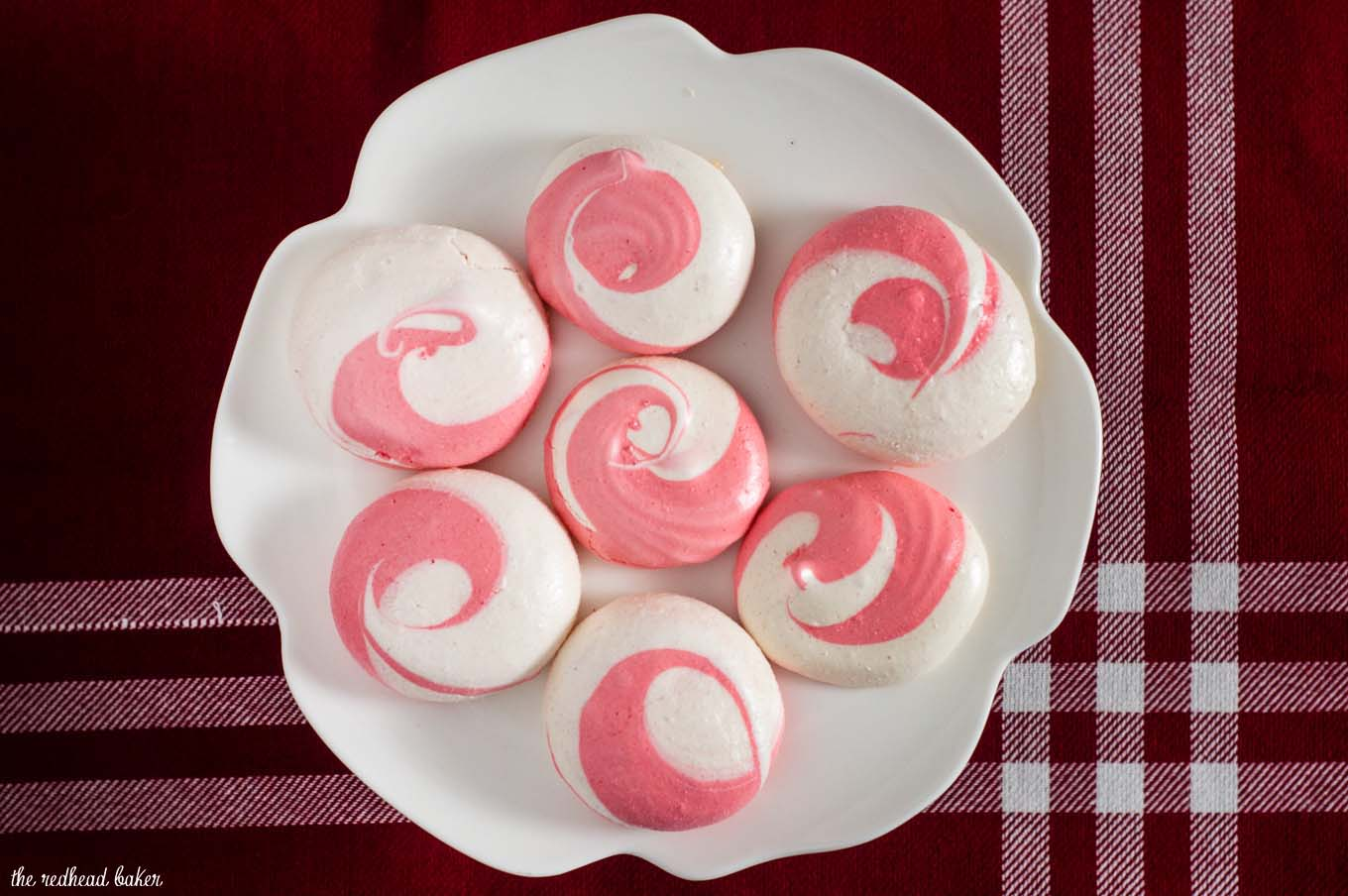 Beautiful swirled peppermint meringue cookies are a festive addition to your holiday party dessert tray! Bonus: they're naturally fat-free! #SundaySupper