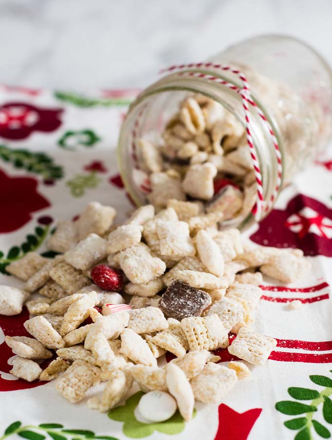 When you leave out Santa's cookies and milk, don't forget the reindeer chow! This snack mixes white chocolate muddy buddies with peppermint treats.
