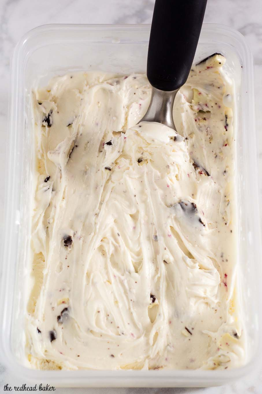 Rich white chocolate peppermint bark ice cream is a delicious holiday treat, with bits of the popular Christmas treat mixed throughout the ice cream.