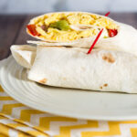Customize these freezer-friendly egg and cheese breakfast burritos however you like. In the morning, just unwrap, reheat and go!