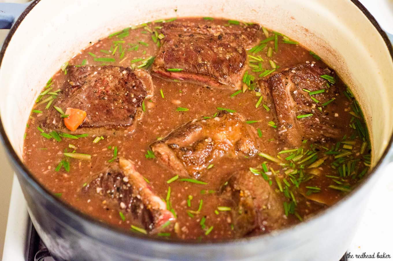Braised short ribs become fall-off-the-bone tender in a mixture of red wine, beef stock, and garlic. Serve over mashed potatoes for a true comfort meal.