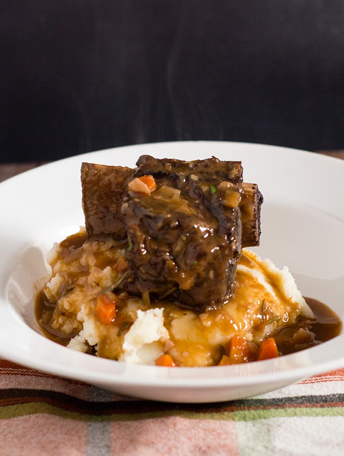 Beef short ribs become fall-off-the-bone tender in a braise of red wine, beef stock, and garlic. Serve over mashed potatoes for a true comfort meal.